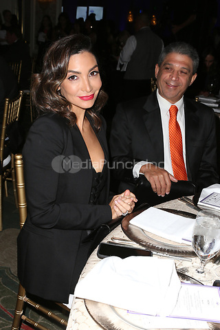 LOS ANGELES, CA - NOVEMBER 8: Courtney Lopez and Aridio Saldaña at the Eva Longoria Foundation Dinner Gala honoring Zoe Saldaña and Gina Rodriguez at The Four Seasons Beverly Hills in Los Angeles, California on November 8, 2018. Credit: Faye Sadou/MediaPunch