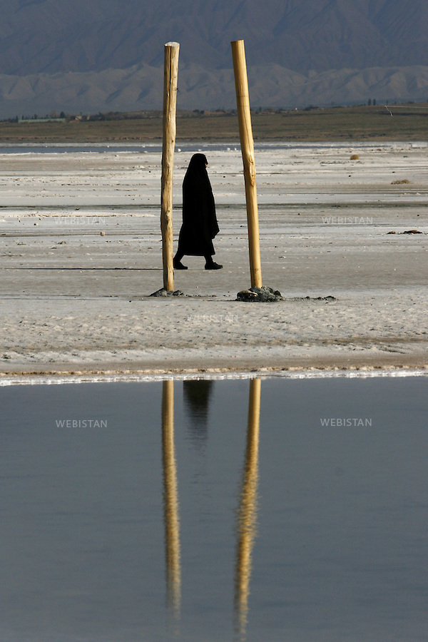 IRAN.NORTH WESTERN IRAN. ORUMIEH LAKE. 24/06/2009: Orumieh Lake in North Western Iran, the third largest saltwater lake on earth with a surface area of 5,200 square kilometers, is drying up. A woman walking on dried lake of Orumieh in Sharafkhaneh port.