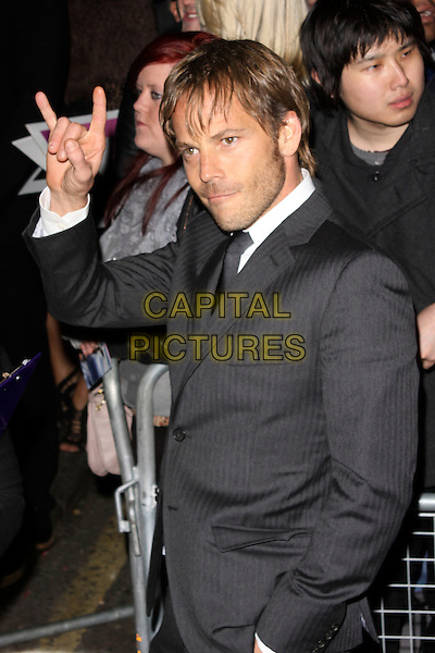 STEPHEN DORFF.The ELLE Style Awards 2011 at Grand Connaught Rooms, London, England..February 14th, 2011.half length grey gray suit jacket stubble facial hair hand fingers gesture .CAP/AH.©Adam Houghton/Capital Pictures.