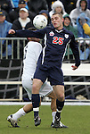 13 December 2009: Virginia's Will Bates (25) and Akron's Chris Korb (behind). The University of Akron Zips played the University of Virginia Cavaliers at WakeMed Soccer Stadium in Cary, North Carolina in the NCAA Division I Men's College Cup Championship game.