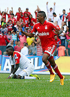 BUGA -COLOMBIA-14-03-2015. Jeison Lucumi celebra un gol anotado a Popayan durante el encuentro entre América de Cali y Universitario de Popayán por la fecha 5 del Torneo Aguila 2015 jugado en el estadio Hernando Azcarate de la ciudad de Buga./ Jeison Lucumi celebrates a  goal scored to Popayan during the match between America de Cali and Universitario de Popayan for the 5th date of Aguila Tournament 2015  played at Hernando Azcarate stadium in Buga city. Photo: VizzorImage/Juan C. Quintero/STR