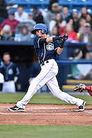 Asheville Tourists shortstop Emerson Jimenez (14) swings at a pitch during a game against the Greenville Drive on April 16, 2015 in Asheville, North Carolina. The Tourists defeated the Drive 5-4. (Tony Farlow/Four Seam Images)