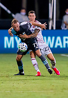 17th July 2020, Orlando, Florida, USA;  Real Salt Lake defender Aaron Herrera (22) fouls Minnesota United defender Chase Gasper (77) during the MLS Is Back Tournament between the Real Salt Lake versus Minnesota United FC on July 17, 2020 at the ESPN Wide World of Sports, Orlando FL.