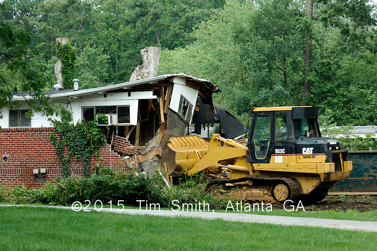 Another house in an established Atlanta neighborhood is torn down to make way for a mini-McMansion which will be rapidly, if somewhat poorly constructed, on the same property by crews of illegal aliens.  This pattern of physical, social and economic destruction and profiteering is part of the unfettered, unplanned and unsustainable growth model popular right now in Atlanta among builders and bankers.  The insane rate of growth and total lack of resource planning has lead the community as a whole to crisis as the primary water source, Lake Lanier, proves unable to provide sufficient water for drinking and bathing, much less to maintain new landscapes and businesses in the metro area.
