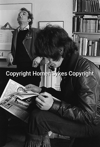 Patrick Procktor artist London 1968. Patrick with Gervase Griffiths who is reading a first copy of the Black Dwarf. Manchester Street flat. <br /> Gervase Griffiths was a former Gordonstoun head boy.  Muse to PP, a model and the lead singer with a psychedelic folk band of little note called Noah and the Quince. ( Picture used in Patrick Procktor Self-Portrait.)