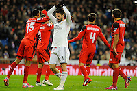 Real Madrid´s Isco and Sevilla's Grzegorz Krychowiak, Timothee Kolodziejczak and Daniel Carrico during 2014-15 La Liga match between Real Madrid and Sevilla at Santiago Bernabeu stadium in Alcorcon, Madrid, Spain. February 04, 2015. (ALTERPHOTOS/Luis Fernandez) /NORTEphoto.com