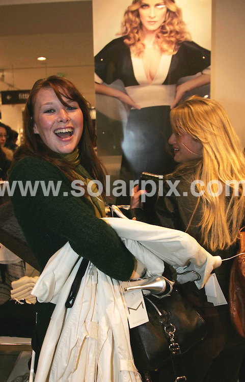 **ALL ROUND PICTURES FROM SOLARPIX.COM**.**NO UK NEWSPAPER PUBLICATION **UK MAGAZINE PUBLICATION ONLY** AND NO PUBLICATION IN FRANCE, SCANDINAVIA, AUSTRALIA AND GERMANY** .M clothing launch - Eager shoppers in H&M store on Londons Oxford Street purchasing the latest clothing and accessories from the M range designed by Madonna ...JOB REF:   3550      SFE       DATE: 22.03.07.**MUST CREDIT SOLARPIX.COM OR DOUBLE FEE WILL BE CHARGED* *UNDER NO CIRCUMSTANCES IS THIS IMAGE TO BE REPRODUCED FOR ANY ONLINE EDITION WITHOUT PRIOR PERMISSION*