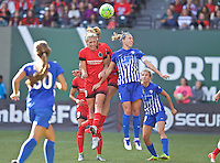 Portland, Oregon - Sunday September 4, 2016: Portland Thorns FC midfielder Allie Long (10) and Boston Breakers defender Whitney Engen (4) head the ball during a regular season National Women's Soccer League (NWSL) match at Providence Park.