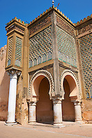 Bab Mansour gate, named after the architect, El-Mansour, completed in 1732. The design of the gate plays with Almohad patterns. It has zellij mosaics and the marble columns were taken from the Roman ruins of Volubilis. Meknes, Morocco