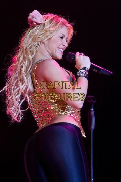 Shakira.Concert in Moscow, Russia..May 24th, 2011.stage concert live gig performance performing music in on half length gold chainmail top belly stomach midriff black trousers cuff bracelet singing side profile .CAP/PER/SB.©SB/PersonaStars/CapitalPictures