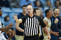 CHAPEL HILL, NC - JANUARY 4: Official Brian Dorsey calls a foul during a game between Georgia Tech and North Carolina at Dean E. Smith Center on January 4, 2020 in Chapel Hill, North Carolina.
