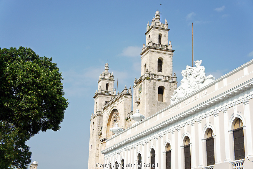 The Bishop's Palace or Peninsula Athenaeum and cathedral on Plaza Grande, Merida, Yucatan, Mexico...