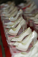"COPY BY TOM BEDFORD<br /> Pictured: Some of the brides' shoes on display at the John Pye Auctions warehouse in Pyle, south Wales, UK.<br /> Re: A bride cried tears of joy after her missing wedding dress was found among a pile of 20,000 gowns in a warehouse.<br /> Meg Stamp, 27, paid £1,300 for the beautiful ivory lace dress but it  was seized by liquidators after a bridal company went bust.<br /> It was boxed up along with 20,000 others and due to be sold for a knock-down price at auction.<br /> But determined Meg banged on the auctioneer door saying: ""I want my dress back"".<br /> Staff at John Pye auctioneers in Port Talbot spent three hours sifting through boxes until they finally found Meg's dream dress."