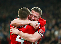 24th November 2019; Bramall Lane, Sheffield, Yorkshire, England; English Premier League Football, Sheffield United versus Manchester United; John Fleck  of Sheffield United gets hug from John Lundstram  of Sheffield United after he scores in the 19th minute to make it 1-0 - Strictly Editorial Use Only. No use with unauthorized audio, video, data, fixture lists, club/league logos or 'live' services. Online in-match use limited to 120 images, no video emulation. No use in betting, games or single club/league/player publications