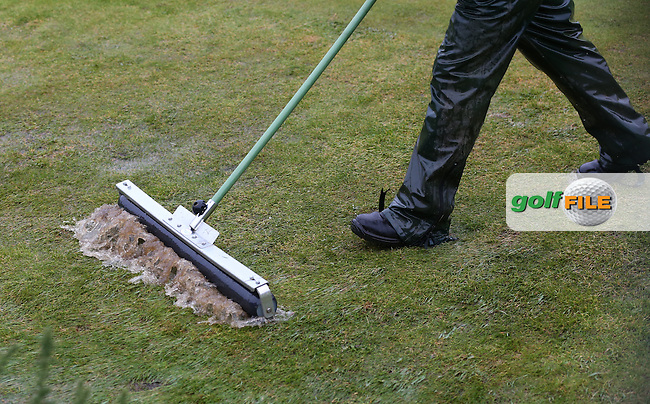 It was touch and go for further delays and postponement as green keeping staff had to treat surface water during play during R3 at Kingsbarns of the 2014 Alfred Dunhill Links Championship, The Old Course, St Andrews, Fife, Scotland. Picture:  David Lloyd / www.golffile.ie