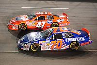 May 1, 2009; Richmond, VA, USA; NASCAR Nationwide Series driver Shelby Howard (70) races alongside Michael McDowell during the Lipton Tea 250 at the Richmond International Raceway. Mandatory Credit: Mark J. Rebilas-