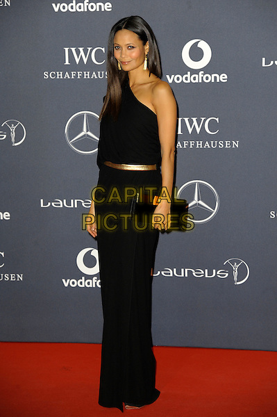 Thandie Newton.Arrivals at the Laureus 2012 World Sports Awards held at the Queen Elizabeth II Centre, London, England..February 6th, 2012.full length black dress one shoulder clutch bag.CAP/CAS.©Bob Cass/Capital Pictures.