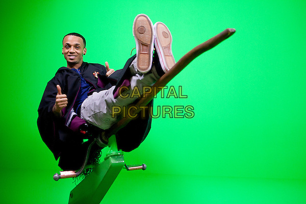 Aston Merrygold.JLS visit the Warner Bros. Studio Tour London The Making of Harry Potter to record a special live episode of Blue Peter. As well as the new green screen broom experience the band take a tour of the sets including Diagon Alley, The Potions Room, The Great Hall & The Weasley's Kitchen..London, England..*Editorial Use Only*.March 21st, 2012.full length black cape robe broom riding quidditch funny leaning hands thumbs up.CAP/NFS.Supplied by Capital Pictures.