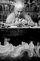 Artisan wood carver and furniture restorer, Luigi Mecocci, in his workshop (bottega) on Via dei Velluti, Florence, Italy