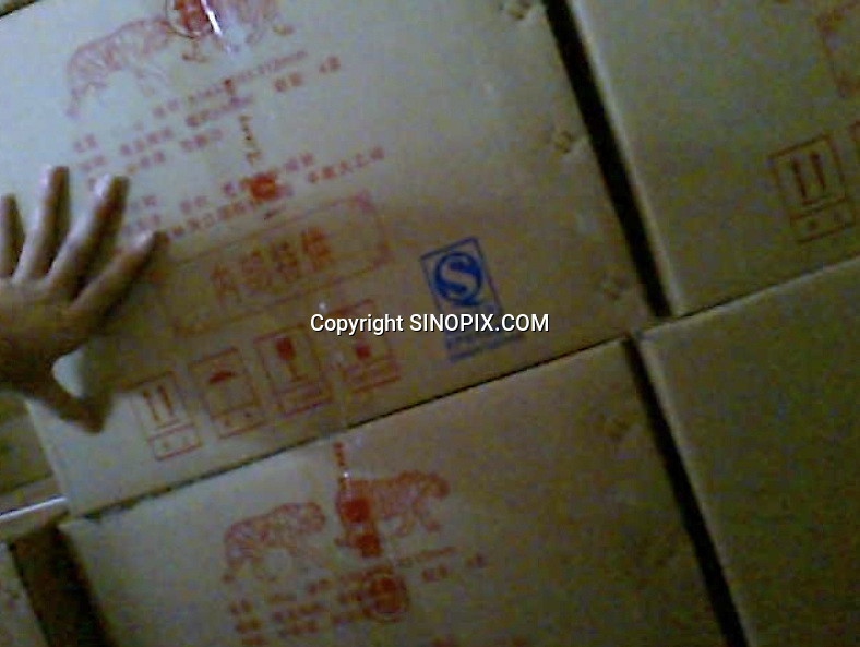 Boxes of tiger bone wine for sale in the Xiongshen Tiger and Bear Park in Guilin China. The park has farmed 1500 tigers and sells an illegal tiger bone wine to tourists that visit the park.