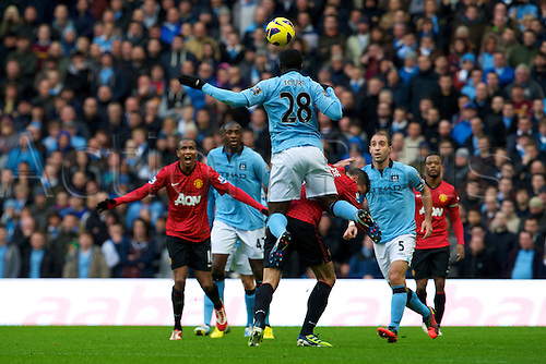 09.12.2012 Manchester, England. Manchester City's Ivory Coast defender Kolo Touré in action during the Premier League game between Manchester City and Manchester United from the Etihad Stadium. Manchester United scored a late winner to take the game 2-3.