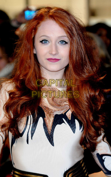 Janet Devlin .arriving at the UK premiere for 'The Twilight Saga: Breaking Dawn - Part One' at the Westfield East Shopping Centre, Stratford City, London, UK,.16th November 2011..portrait headshot black white eyeliner make-up beauty dyed red hair x factor patterned .CAP/WIZ.© Wizard/Capital Pictures.