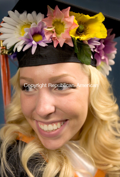 WATERTOWN CT. 20 June 2014-062014SV15-Jillian Noseworthy, 18, gets ready for graduation with her flowered cap during graduation ceremonies at the high school in Watertown Friday. <br /> Steven Valenti Republican-American