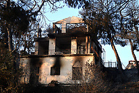 Pictured: A damaged house in the area.<br />