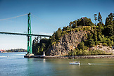 CANADA, Vancouver BC, just after leaving Vancouver BC, the Holland America cruise ship, the Oosterdam, passes under the Lion's Gate Bridge by Stanley Park, British Columbia