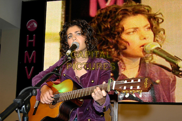 KATIE MELUA.Instore gig & signing at HMV, 150 Oxford Street, W1, London..September 26th, 2005.half length guitar singing.www.capitalpictures.com.sales@capitalpictures.com.©Capital Pictures