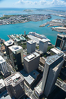 Aerial of downtown Honolulu and harbor with Aloha Tower and cruise ship