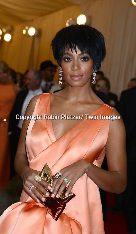 Solange Knowles attends the Costume Institute Benefit on May 5, 2014 at the Metropolitan Museum of Art in New York City, NY, USA. The gala celebrated the opening of Charles James: Beyond Fashion and the new Anna Wintour Costume Center.