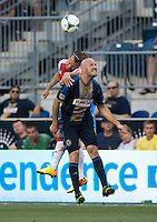 Conor Casey (6) of the Philadelphia Union goes up for a header with Michael Harrington (5) of the Portland Timbers during a Major League Soccer game at PPL Park in Chester, PA.  Philadelphia Union tied the Portland Timbers, 0-0.