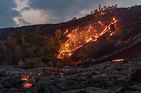 At dusk, lava rivers flow down Pulama Pali (part of Holei Pali), Hawai'i Volcanoes National Park, Puna district, Hawai'i Island, December 2017.