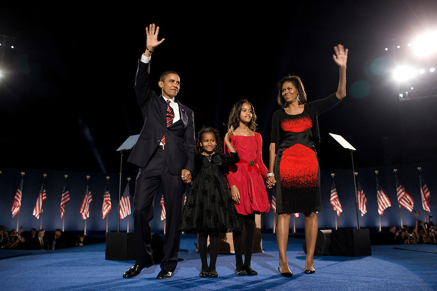 President-elect Barack Obama, left, his wife Michelle Obama, right, and two daughters, Malia, and Sasha, center left, wave to the crowd at the election night rally in Chicago...Photo by Brooks Kraft/Corbis........