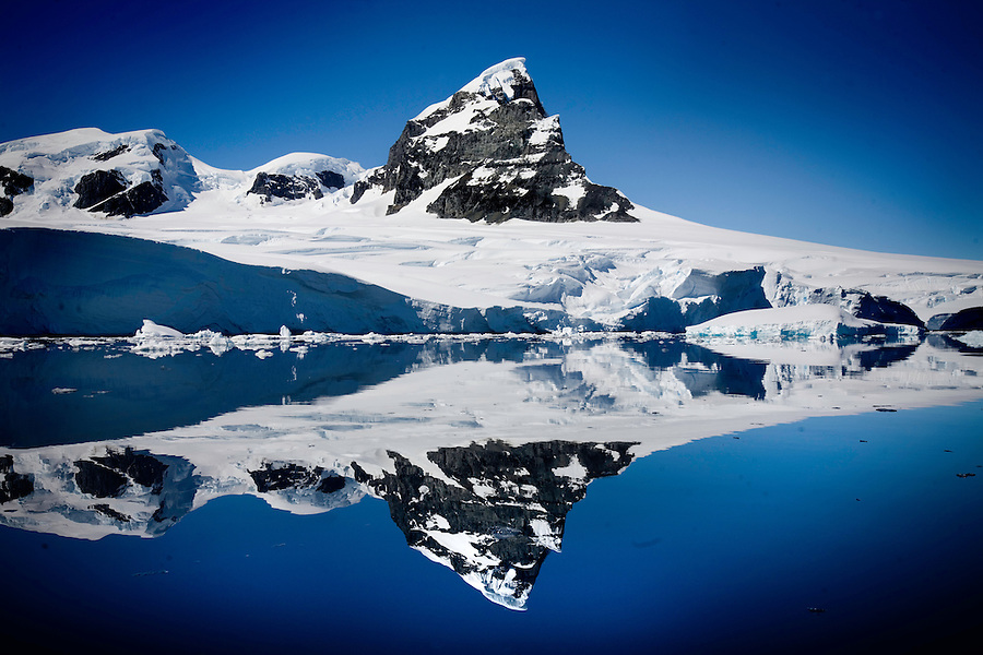 Prospect Point, Antarctica, Jan. 9, 2007 - A near mirror image of a peak in the smooth waters of Holtedahl Bay.