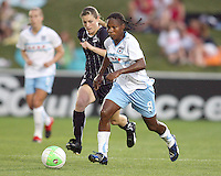 Jill Gilbeau #3 of the Washington Freedom tries to catch Formiga #8 of the Chicago Red Stars during a WPS match at the Maryland Soccerplex, in Boyds Maryland on June 12 2010. The game ended in a 2-2 tie.