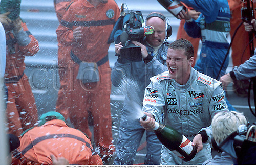 DAVID COULTHARD (GBR), McLaren Mercedes, celebrates his win by spraying Champagne, Monaco F1 Grand Prix, 000604. Photo:  Action Plus...2000.formula one f1.driver drivers.motor sport.motorsport.motorsports.celebration.celebrate.celebrating.celebrations.joy GP