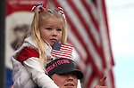 Nikki Nyhammer and her daughter Chevi Nyhammer-Atwell, 5, watch the Veteran's Day Parade in Virginia City, Nev., on Tuesday, Nov. 11, 2014.<br /> Photo by Cathleen Allison