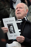 Pictured: A Newcastle supporter singing welsh hymn Bread of Heaven in tribute to former Newcastle player and Wales manager Gary Speed. Saturday 17 December 2011<br /> Re: Premier League, Newcastle United FC v Swansea City FC at St James' Park, Newcastle Upon Tyne.