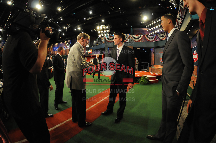 Shortstop Gavin Cecchini (Barbe H.S.) the number tweleve overall pick to the New York Mets with MLB Commissioner Bud Selig during the MLB Draft on Monday June 04,2012 at Studio 42 in Secaucus, NJ.   (Tomasso DeRosa / Four Seam Images)