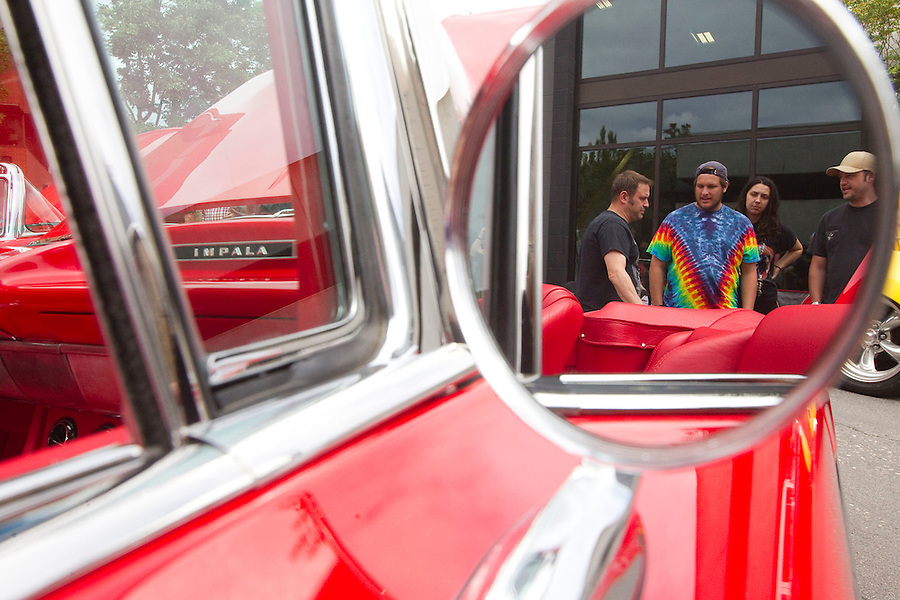 "Visitors admire a vintage Impala at ""Crusin' the Guton Main Street in downtown Vancouver Saturday July 16, 2016. ""Cruisin' the Gut""  is an annual event in which antique car enthusiasts drive up and down main street,. (Photo by Natalie Behring/ for the The Columbian)"