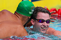 Picture by Alex Whitehead/SWpix.com - 05/04/2018 - Commonwealth Games - Swimming - Optus Aquatics Centre, Gold Coast, Australia - Ben Proud of England and Chad le Clos of South Africa in the Men's 50m Butterfly heats.