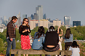 Covid-19 pandemic.  Primrose Hill, London, where lockdown rules regarding social distancing, sun-bathing and picnicing are not consistently observed.
