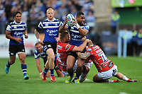 Joe Cokanasiga of Bath Rugby is tackled by Ed Slater and Jason Woodward of Gloucester Rugby during the Gallagher Premiership Rugby match between Bath Rugby and Gloucester Rugby at The Recreation Ground on Saturday 8th September 2018 (Photo by Rob Munro/Stewart Communications)