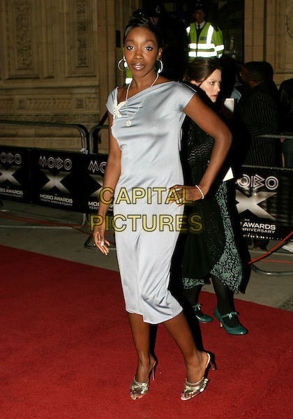 ESTELLE.MOBO Awards 2005. Royal Albert Hall, SW7, London..September 22nd, 2005.full length hand on hip grey gray blue dress.www.capitalpictures.com.sales@capitalpictures.com.© Capital Pictures.