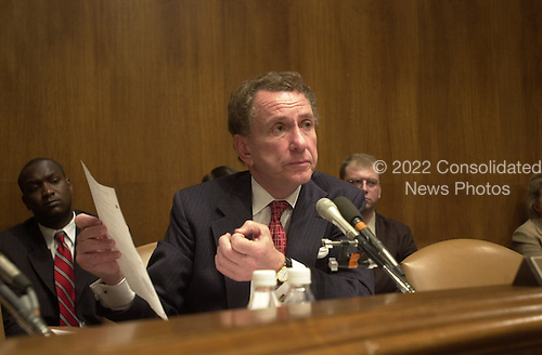 United States Senator Arlen Spector (Republican of Pennsylvania), Acting Chairman of the U.S. Senate Judiciary Committee, reads from a document related to the pardon of Marc Rich to Roger Adams and Eric Holder on February 14, 2001 in Washington, D.C..Credit: Ron Sachs / CNP