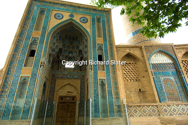 The Jameh (Friday) Mosque in Natanz, Iran is well-known for its unusually high entrance portal and the turquoise, black and white symmetrical tiled calligraphy which decorates it.