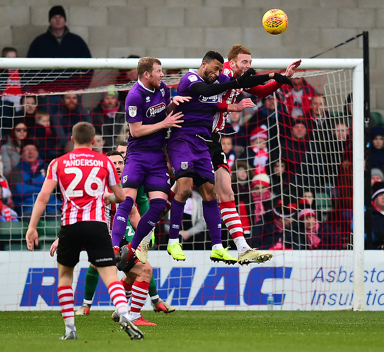 Lincoln City's Cian Bolger heads clear under pressure from  Grimsby Town's Wes Thomas<br /> <br /> Photographer Andrew Vaughan/CameraSport<br /> <br /> The EFL Sky Bet League Two - Lincoln City v Grimsby Town - Saturday 19 January 2019 - Sincil Bank - Lincoln<br /> <br /> World Copyright © 2019 CameraSport. All rights reserved. 43 Linden Ave. Countesthorpe. Leicester. England. LE8 5PG - Tel: +44 (0) 116 277 4147 - admin@camerasport.com - www.camerasport.com