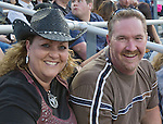 Rebecca Gill, with birthday boy Sean, laugh during the Reno Rodeo on Saturday, June 20, 2015.